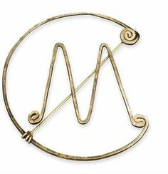 Alexander Calder Brooch | Made for Mary Callery.  Brass and steel wire.  circa 1950.