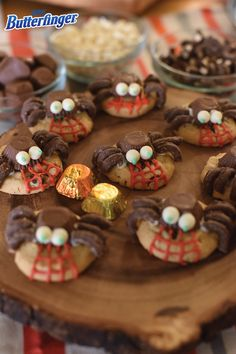 Your Halloween costume party wouldn't be complete without an array of candy treats to serve your ghoulish guests. Make the dessert table stand out with these quick and easy, but totally festive Butterfinger Peanut Butter Cup Mini Spiders. Simply top peanut butter cookies with BUTTERFINGER® Peanut Butter Cup Minis and then decorate to create the look of a creepy crawly spider!