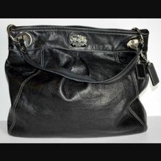"""Coach Madison Leather Crossbody Beautiful, roomy bag. Black leather with silver hardware. Excellent condition, barely noticeable scratch on back (last pic), could probably be buffed out. Interior is perfectly clean. Longer cross body strap is removable or can be tucked inside. 14"""" high x 13.5"""" wide, 2.5"""" deep. 7"""" handle/shoulder strap drop. 19"""" cross body/shoulder strap drop. Snap closure. Interior zip, wall & cell phone pockets. Dust bag included. Coach Bags"""