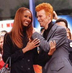 """Rocker and film star David Bowie chats with his wife, supermodel Iman, before receiving the 2,083rd star on the Hollywood Walk of Fame in the Hollywood section of Los Angeles, Wednesday, Feb. 12, 1997. Bowie released his latest album, """"Earthling,"""" on Tuesday. Photo: SFC"""