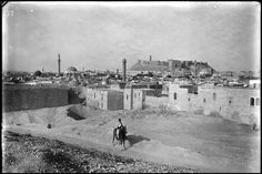 A view of Aleppo from the southwest showing the Citadel on a hill in the center, circa 1898. Aleppo is one of the oldest continually inhabited cities in the world, and the Citadel is one of the oldest and largest fortified castles. The ancient city was named a UNESCO World Heritage Site in 1986.