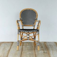 """Woven in crisp black and white for graphic appeal, this rattan chair makes a comfortable seat indoors and out.- Natural manao rattan, polyurethane (synthetic rattan)- Wipe clean with soft, dry towel; synthetic rattan may be washed with mild soap and water- Indoor or sheltered outdoor use- Seat: 18.1""""H, 18.1""""D- Imported36.4""""H, 21.8""""W, 24""""D"""