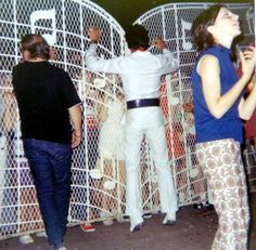 70s Elvis at Graceland gates with Marty Lacker (on the left)