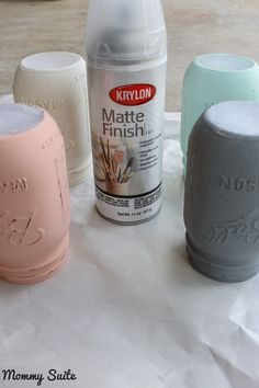 Spray mason jars with a matte finisher to seal and protect the paint. This is a MUST if you want to use for flowers.(Bottle Flower Mason Jars)