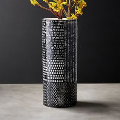 Shop Hash Black and White Vase. Hand-carved vase gets its graphic design from a unique resist process. Wax is applied to the markings then the entire vessel is dipped in black glaze. The wax resists the glaze revealing intricate white markings.