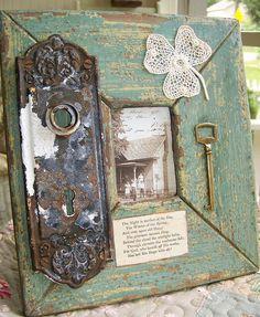 Frame as art...distressed wood frame, vintage door plate, and key
