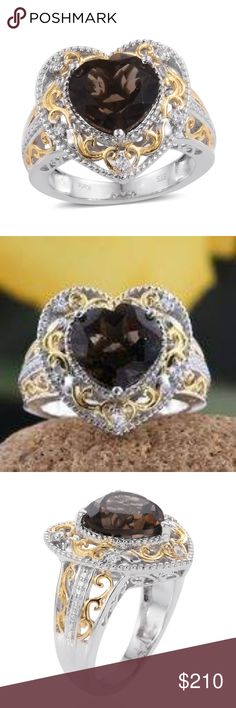 Amazing Brazilian Smoky Quartz Heart Ring.SIZE 7 Amazing Brazilian Smoky Quartz Heart Ring. Cambodian ION Plated 18 K YG and Platinum Bond Brass Heart Ring. Size 7.  5.85 total carats.  Minimum of 5 carats center Smoky Quartz. Cambodian Zircon  embedded on halo around the center stone. Delicate Victorian filigree and two tone 18 YG design throughout. Finished under-gallery. Exquisite!! Ring can be sized. Tell me what you need, and I'll find it for you! Brazilian Smoky Quartz Jewelry Rings