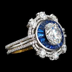 Alexandra Mor Platinum and gold ring with round cut diamonds colorless / trapezoid cut blue sapphires and brilliant .