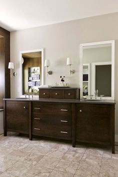 In this remodeled bathroom, the style is traditional with a modern twist. A furniture-style cherry-paneled vanity offers each person a devoted space. A row of shared apothecary drawers separates the two sinks. Durable, easy-to-maintain quartz-surfacing tops the vanity, and stone underfoot will stand the test of time.