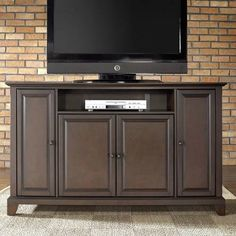 New TV Stand for Living Room eventually...love the black tv stand this link leads to!