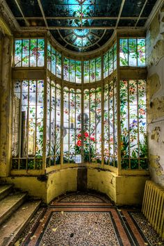 An abandoned Chateau in France - Stained glass floral window. (Location not specified)