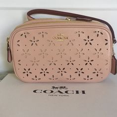 COACH Crossbody Laser Cut Bag Peach Rose 'glitter' with laser cut flowers will subtly shimmer in bright or dim light !  design has double zip compartments, one has two card sleeves other has full length sleeve. Custom Bundle Only Coach Bags