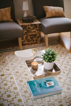 lovely coffee table display, also love the rug