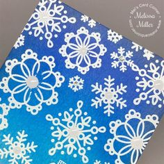 Mel's Card Corner | Blue Christmas After I had all the ink blending finished, I used a dry paper towel to buff over all the embossing. This removed any excess ink left behind during the ink blending process. To finish off the card, I added some white enamel dots in the centers of the larger snowflakes and some rhinestones in the centers of the smaller snowflakes.