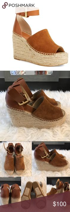 Marc Fisher Espadrille Wedges Marc Fisher Espadrille wedges. Cognac/brown/tan color. Worn a handful of times. Good condition, however the right shoe is missing the piece to tuck the strap back (as seen in last photo).                        •n o  t r a d e s• •s m o k e  f r e e / p e t  f r e e  h o m e•   •s a m e / n e x t  d a y  s h i p p i n g• Marc Fisher Shoes Espadrilles