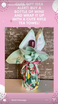 Wine bottle wrapped in Rifle Paper tea towel
