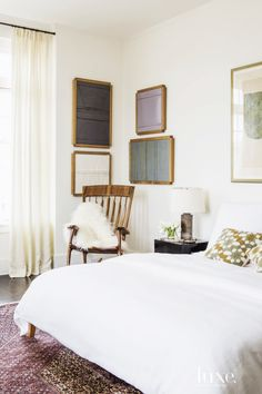 Bedroom corner with small gallery wall and wood rocking chair with sheepskin throw