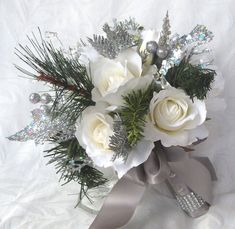 Winter wedding bouquet and boutonniere white roses silver glitter pine, green pine, and crystal gems winter wedding