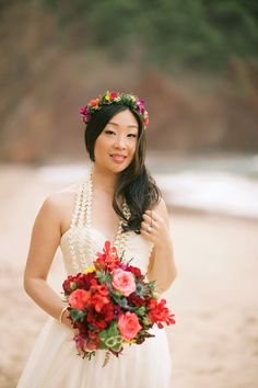 Beautiful bride in a strapless gown + floral crown and bouquet in reds and pinks -- Anna Kim Photography
