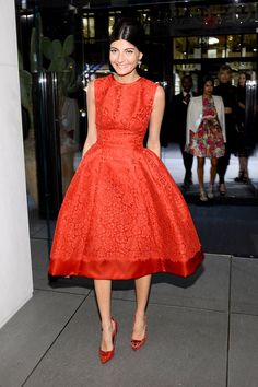 To host the Dolce & Gabbana Fifth Avenue flagship opening festivities, Giovanna Battaglia dressed in a classic red lace full-skirted number from the designers.