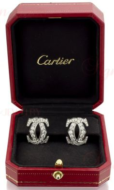 Cartier double C design white gold diamond earring.  France, modern.  The most identifiable sign of the Cartier world is double C design - a symbol of timeless every day elegance. These classic earrings feature an estimated 2.38 carats of sparkling round white diamonds pave-set in 18k white gold. Simply stunning.  GRAM WEIGHT: 16.78  APPROXIMATE CARAT WEIGHT: 2.38