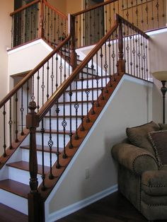 Custom Fabricated Wrought Iron Spindles With Stained Rail