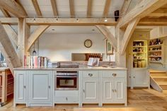 This beautiful Neptune Kitchen was designed by Distinctly Living of Dartmouth and expertly fitted into this wonderful Carpenter Oak kitchen/diner extension. Timber Kitchen, Barn Kitchen, Custom Kitchens, Luxury Kitchens, Kitchen Furniture, Kitchen Interior, Neptune Kitchen, Oak Framed Buildings, Kitchen Diner Extension