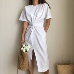 """Elegant Twist Tie Waist and Front Slit Short Sleeve Midi Dress. Really versatile in styling as the waist can be tied at the back or front or tight or loose. This Minimalist solid color cotton dress is perfect for many occasions - casual, office and weekend. 3 Colors: Coffee, Green & White One Free Size : Bust 102cm (40"""") 116cm (45.6"""") Gender: Women Sleeve Length(cm): Short Silhouette: A-Line Style: Casual Material: Polyester,Cotton Sleeve Style: Regular Pattern Type: Solid Dresses Length…"""
