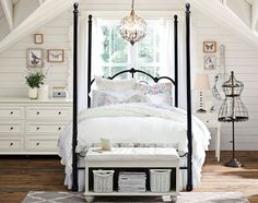 Teenage girls' room idea. Why this room works? A four-poster canopy bed with beautiful iron scrollwork sets the mood for this vintage-inspired space. An intertwining branch chandelier capped with shimmering crystals and framed butterfly art lend an organic touch, while a wire-frame jewelry holder in the shape of a dress form gives it fashion-forward appeal.