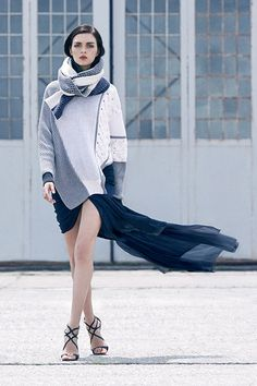 Pair Prabal Gurung's Asymmetrical Mixed Intarsia Sweater with the dainty Draped Silk Mini Skirt for a dramatic effect.