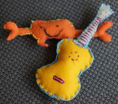 Today my family was making some plushies to give away … Taavi, my six-year-old son, designed a crab that my wife Dixie blew up into a pattern and they both worked on to stitch together. I, of course, made a ukulele. Taavi fell in love with it and took it for a pillow for one of his favorite stuffed animals, so I guess it won't be traveling anywhere like I'd planned. The crab is still going to one of Taavi's favorite friends. Felt Crafts, Ukulele, Stuffed Animals, Plushies, Traveling, Play, Stitch, Friends, Pattern
