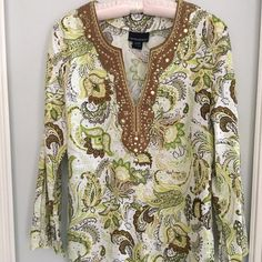 """CYNTHIA ROWLEY Linen Blend Tunic Large Beautiful colors of greens, bronze and ivory in this embellished tunic by Cynthia ROWLEY in size large. Bronze copper large and small coins embellish the piece of 55% linen and 45% rayon with a deep V neck and slit bell sleeves. Armpit to armpit 21"""" and length from top shoulder 28"""". Cynthia Rowley Tops Tunics"""