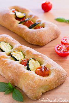 Un'ottima focaccia alle zucchine, con questo splendido ortaggio direttamente nell'impasto, e in versione monoporzione, ideali per i nostri pranzi al sacco