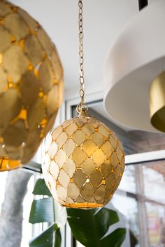 "A handcrafted pendant with numerous leaf-shaped pieces that are fitted together and finished in a hand applied antiqued gold leaf. Dimensions: 14""Dia x 16""H - Materials: Iron - Finish: Antiqued Gold L"