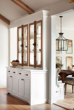 """How to Make Your Kitchen Beautiful with Pretty Cabinet Details, Part 1 (Cabinet Interiors). Joanna Gaines revitalizes the old """"double sided glass cabinet"""" trick of the As beautiful as it is functional, this furniture-style hutch allows light to pass New Kitchen, Kitchen Dining, Kitchen Decor, Dining Rooms, Kitchen Hutch, Dining Room Cabinets, Country Kitchen, Kitchen Wood, Kitchen Island Room Divider"""