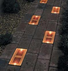 Sun Bricks are solar powered outdoor light fixtures that can be built into a brick or stone walkway. Unlike traditional outdoor lights, sun bricks are designed to be flush with the ground, giving the effect of an illuminated pathway, rather than a path that is flanked by lights.  All their power is generated by the sun. These solar panels can provide an 8-hour charge to the bricks' amber LED.