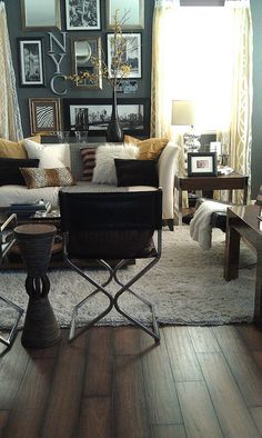 relocating items: previously the pair of thrifted director chairs ($ 13 for pair) were the my bedroom (2010) - now they are in the living room (2012). Mixing in GOLD helped to refresh the look of the yellow