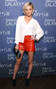 love this outfit.  Ashlee Simpson in Alice + Olivia red leather shorts w/ button-down shirt
