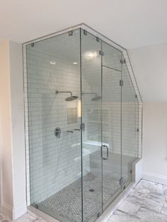 Custom Steam Glass Shower Enclosure - 90 Degree Steam Enclosure with Sloped Ceiling. Contact Arrow Glass and Mirror, located in Austin, TX today to learn more 512-339-4888 or email sales@glassgang.com.