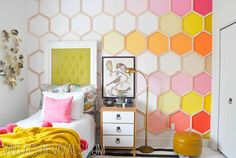 accent wall Great ideas for teen girl's room: bright honyecomb wall treatment and tunfted picture frame headboard