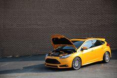 Ford Focus ST mk3 in yellow color Tangerine Scream