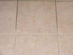 Amazing Grout Cleaner - 3 1/2 c water; 1/4 c baking soda; 2 Tbsp + 2 tsp ammonia; 2 Tbsp vinegar - Mix ingredients & give bottle a good shake. Spray small section of grout & let spray sit & absorb into grout. Be generous. Grab a grout brush and scrub vigorously - DON'T GET IN EYES. Use clean damp rag to wipe residue away. Change or clean rag often. Mop floor when finished.