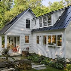 LOVE the exterior of this cape. Love the color and the metal rood - the porch posts are a great and simple design