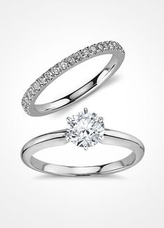We love the classic elegance of coupling a solitaire stone engagement ring and pavé wedding band, both done in platinum.