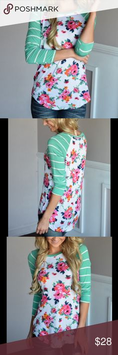 """Turquoise Pink Floral Raglan Top Shirt Casual chic! Gorgeous pink/orange/green/blue and white watercolor floral print on a cute raglan top with minty turquoise striped three-quarter sleeves. Soft polyester.   Sizes run app 1/2 size small, like juniors sizing - go up a size if you're unsure about a loose fit! S: 33"""" bust M: 35.5"""" bust L: 37"""" bust XL: 38"""" bust XXL: 40"""" bust Last photo is me wearing mine, a medium. I'm usually between an adult small & medium in tops. No trades/holds. Bundle for…"""