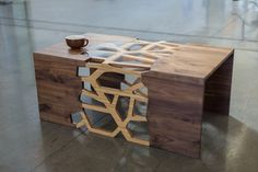 Branching Table.   It is a magnificent piece of craftsmanship that uses traditional Japanese joinery techniques to create an intricate design that does not rely on nails or screws. The geometric branching of the bamboo center design creates an intriguing design and a great place to come together with friends and loved ones over coffee.   #sondermill #coffeetable