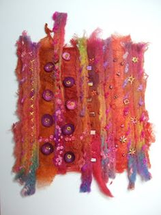 """Emmelinesplace: just a small piece - 6"""" x 6"""" layered felt, muslin, silk carrier rods, knitting yarn, wool tops mushed together using the embellisher machine, then hand stitched with a few beads"""