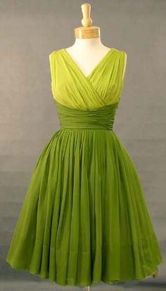 "A GORGEOUS two toned green chiffon cocktail dress! Heavily gathered sleeveless bodice with surplice bust and set-in waist. Dress has a full, twirling skirt (shown here with a small crinoline... not included). Dress is fully lined. Rear metal zipper. ""Miss Elliette,"" label."