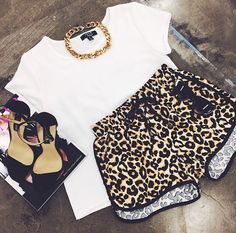 Leopard shorts. White tee. Gold link chain. Ankle strap heels