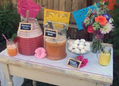 "Aguas frescas and traditional mexican wedding cookies. I think this would be cute to have as a non-alcoholic ""self-serve"" drink table. And I love the paper flags. would be so pretty as decor in all navy or all white! Taco Bar Buffet, Fresco, Mexican Themed Weddings, Mexican Wedding Cookies, Fiesta Theme Party, Drink Table, Beverage Table, Mexican Party, Mexican Style"